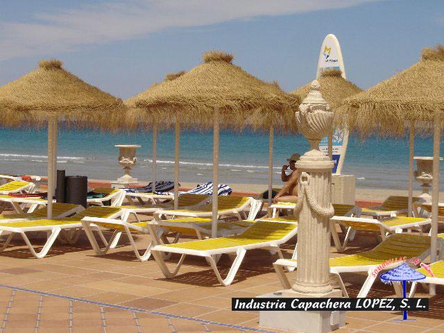 Las sombrillas de playa de tela for Tela para sombrillas